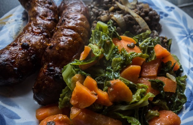 Italian sausages with lentils, carrots and cabbage